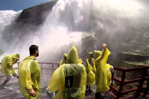 Getting wet doing the Cave of the Winds on a Niagara Falls Private Tour