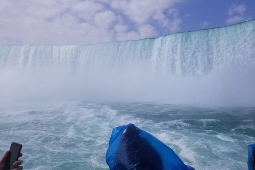 the maid of the mist heading into the base of Niagara Falls