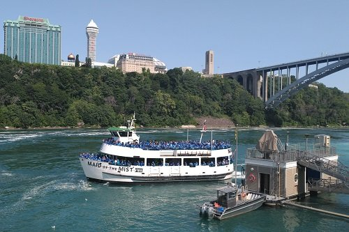A tour group aboard the Maid of the Mist in Niagara Falls